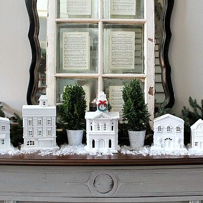 Thrifty idea for a White Christmas village using building from Goodwill