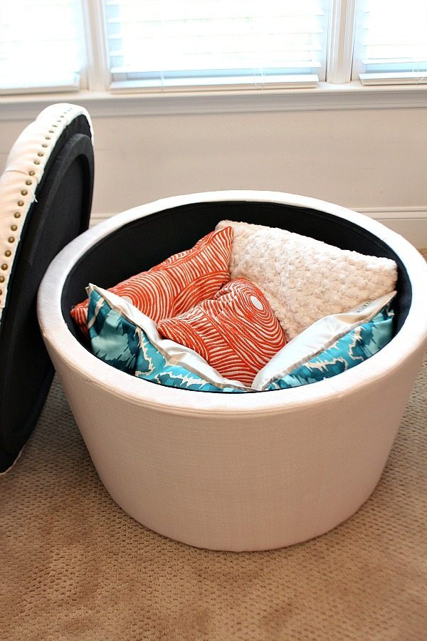 Storage ottoman, great to use in the closet. More ideas for closet organization at Refresh Restyle