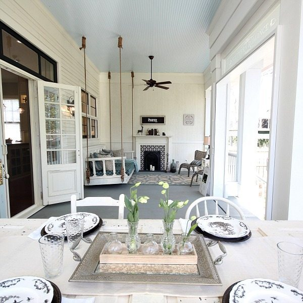 Back porch living at Southern Romance Phantom Screen Idea Home in Mobile Al