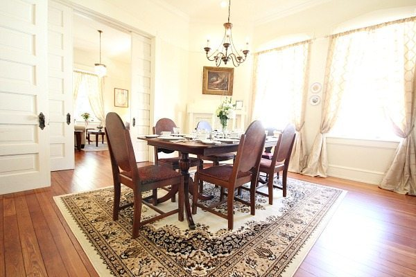 Dining Room at Southern Romance Phantom Screen Idea Home in Mobile Al