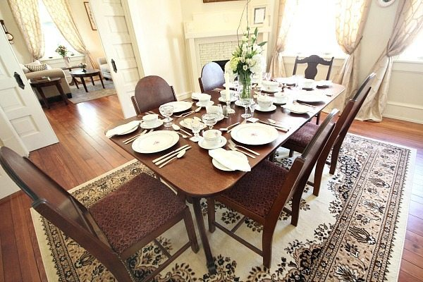 Dining table set with antique finds at Southern Romance Phantom Screen Idea Home in Mobile Al
