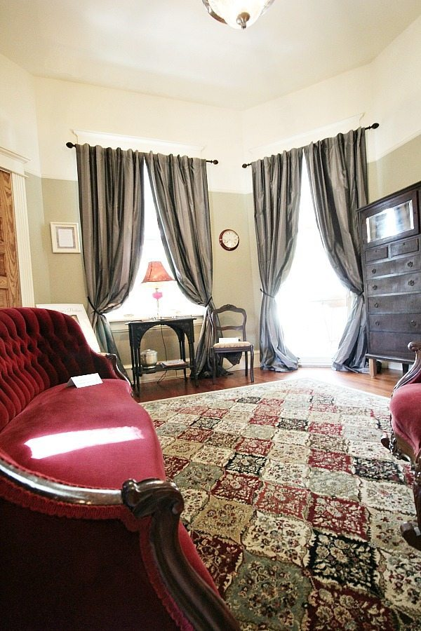 Gentleman's parlor at Southern Romance Phantom Screen Idea Home in Mobile Al