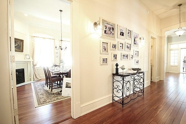 Hall way at the Southern Romance home - pictures frames were made from molding rescued from the makeover
