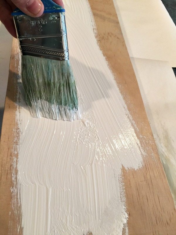 Paint your board with craft paint or chalk paint let it dry and create your farmhouse sign