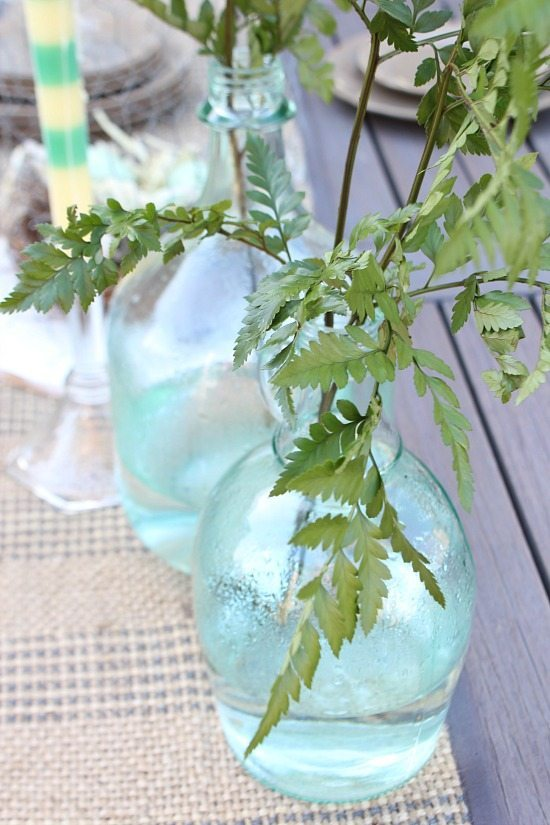 Ferns in old bottles deck dining Refresh Restyle spring home tour