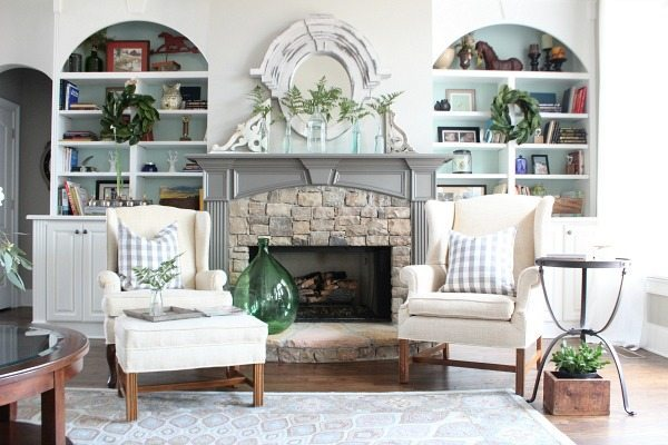 Fireplace ferns and old bottles living room Refresh Restyle spring home tour