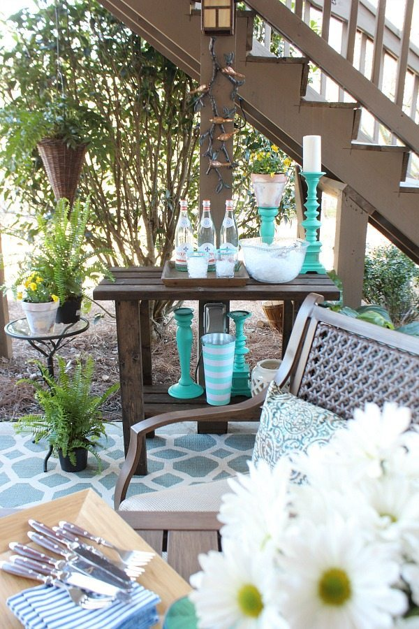 Outdoor living - Beautiful aqua and navy melamine serve ware - Outdoor Patio Refresh - Spring is here and so is entertaining season. We love spending time outside Patio refresh with blues - potting bench serving area