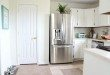 Cottage Kitchen Cabinet makeover with SW Dover White and original hinges