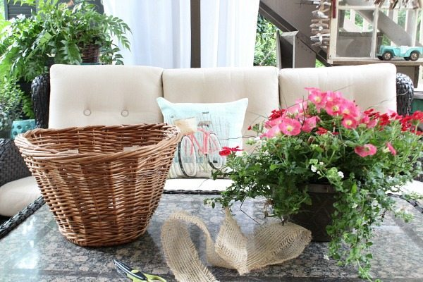 Bicycle basket becomes a planter - a thrift store makeover for outdoor decor at refreshrestyle.com