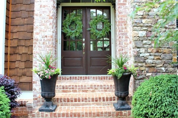 Double doors that say welcome to Refresh Restyle