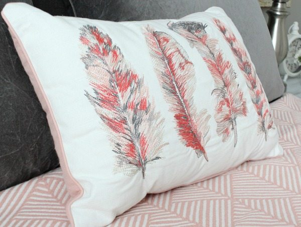 Feather pillow - Guest room with corals and gray at refreshrestyle.com