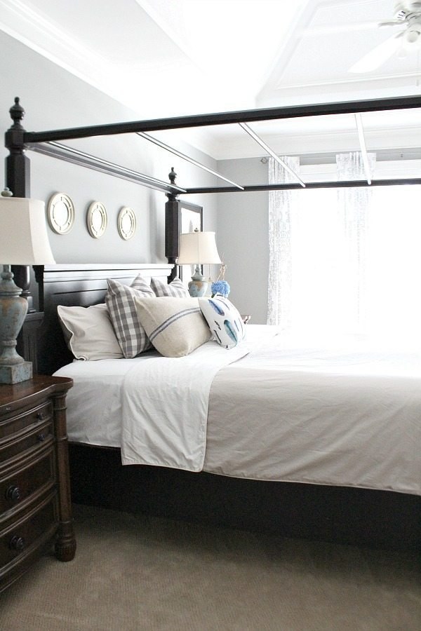 Master bedroom with grays light and bright space at RefreshRestyle.com