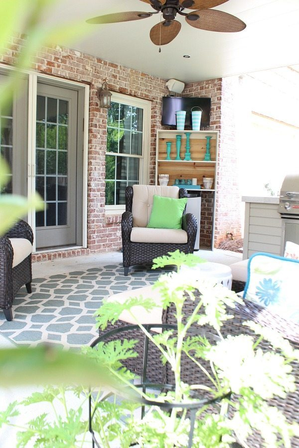 Summer patio with tv and build in grill area at RefreshRestyle.com