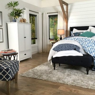 Light gray walls and dark blinds - Farmhouse Bedroom in Navy with shiplap wall and padded headboard at Refresh Restyle