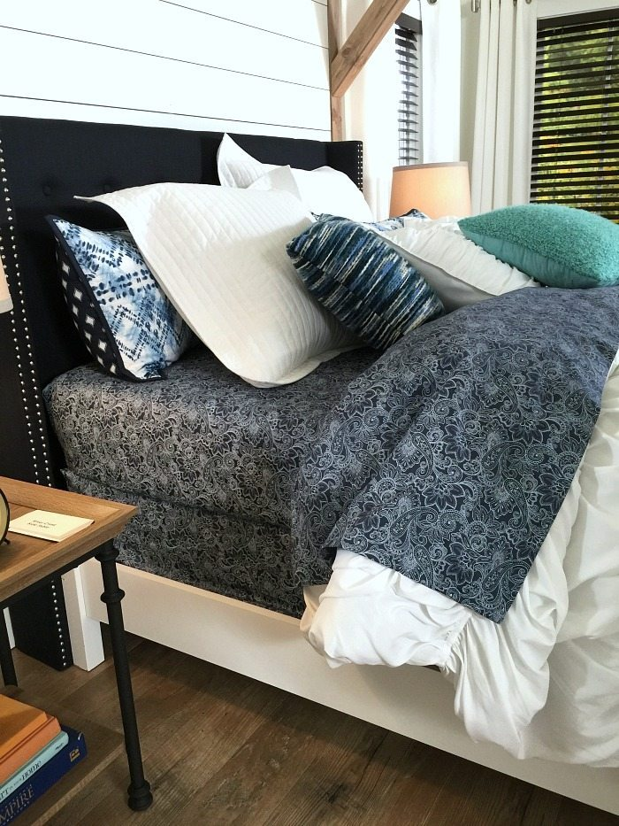 Navy and White Classic colors -Farmhouse Bedroom in Navy with shiplap wall and padded headboard at Refresh Restyle