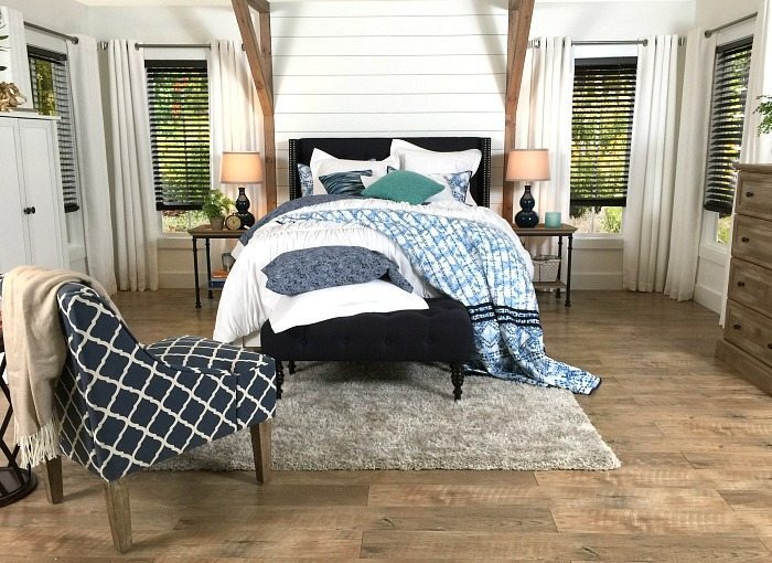 Shiplap behind the bed - Farmhouse Bedroom in Navy with shiplap wall and padded headboard at Refresh Restyle