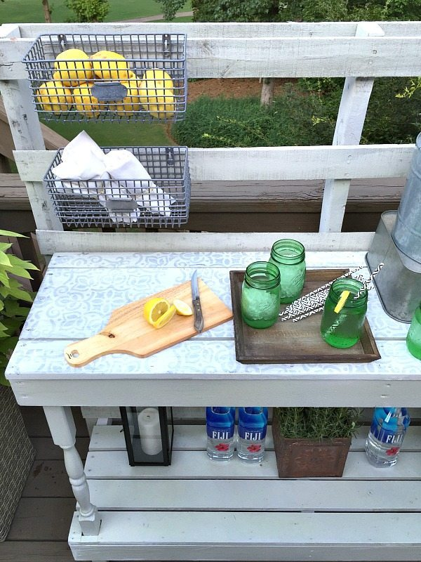 Stenciled and painted - Dining -Rustic farmhouse serving area idea - Made from a pallet - outdoor potting table serves as buffet or drink service area