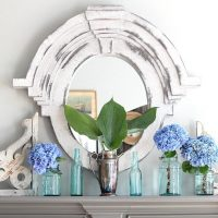 Aqua mason jars and soda bottles are perfect for holding hydrangeas on the mantel