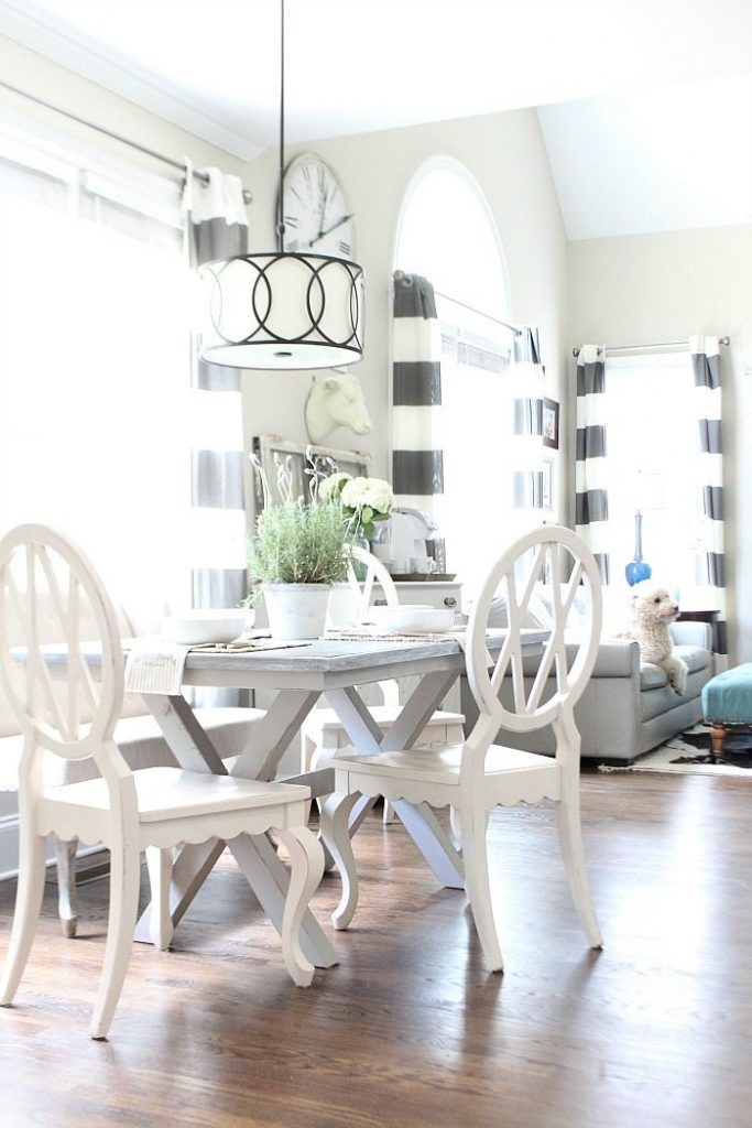Farm table painted gray with x-base love the light and bright dining area