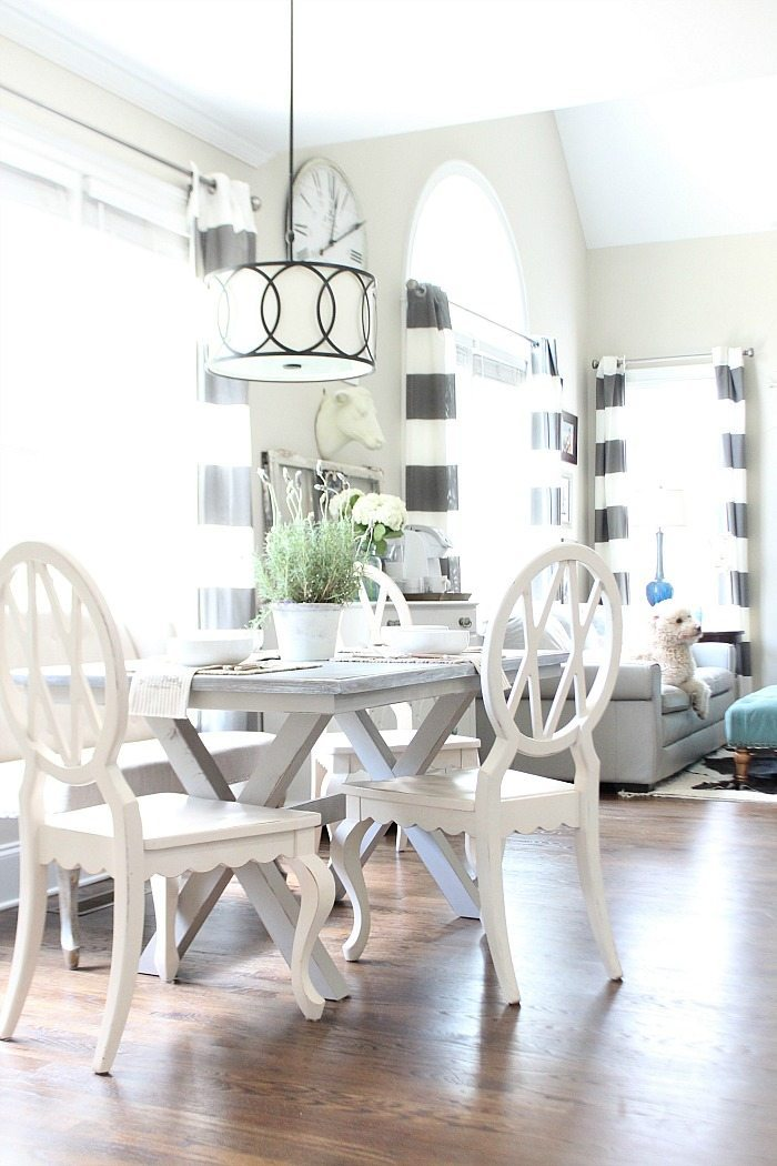 Farm table painted gray with x-base love the light and bright dining area - DIY furniture makeover from brown to fabulous gray