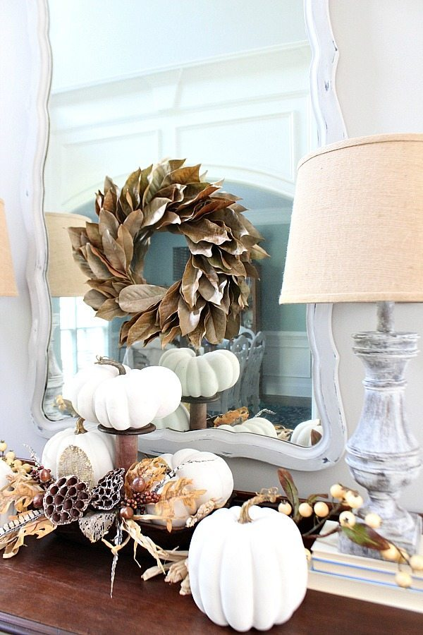 Farmhouse entry with white pumpkins for fall