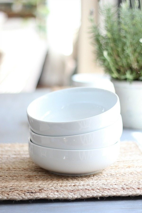 White bowls and natural placemats