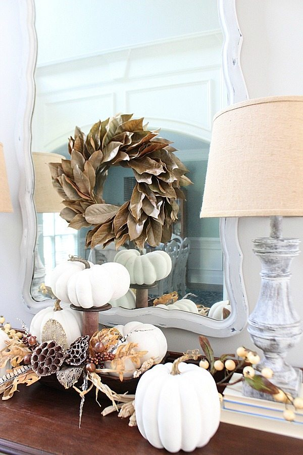 White pumpkins dried hydrangea and feathers for a bright fall idea at Refresh Restyle