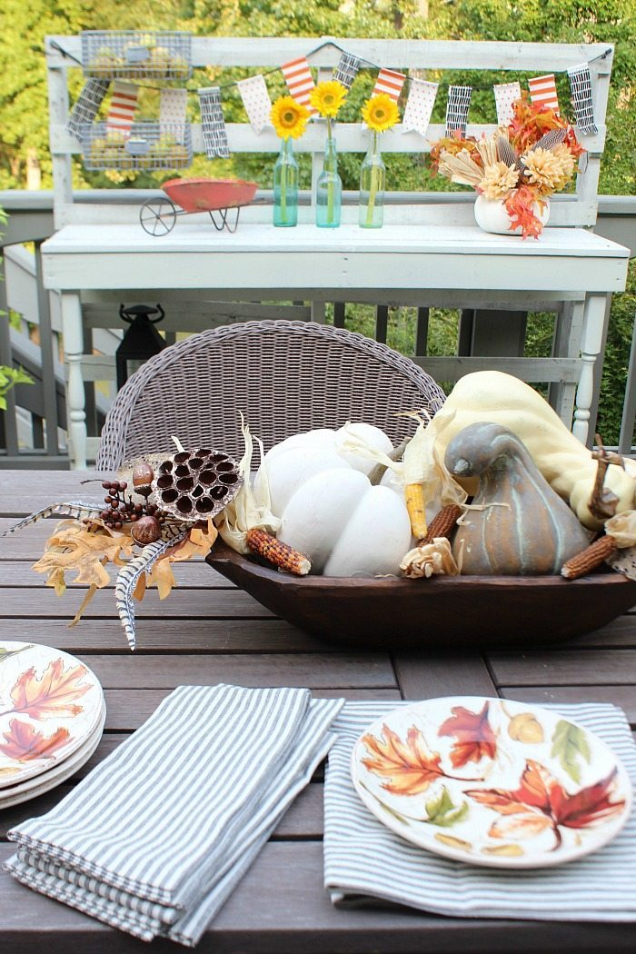 dough-bowl-filled-with-faux-pumpkins-on-the-back-porch-at-refresh-restyle