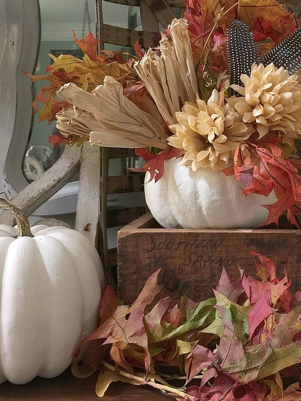 Feathers mums and corn husk in white pumpkins at Refresh Restyle