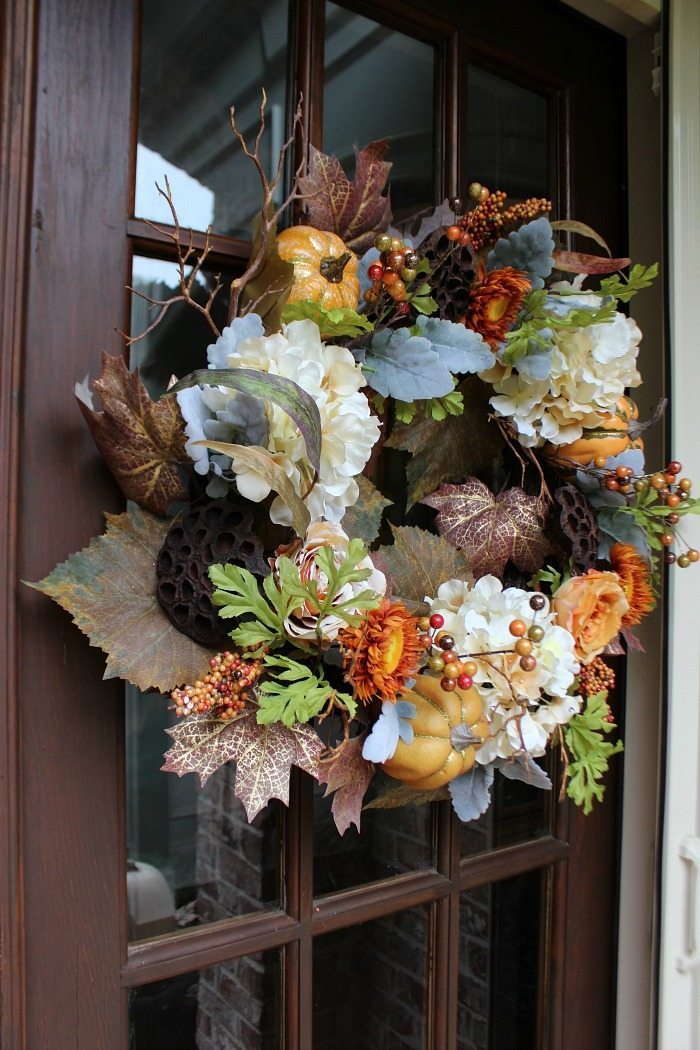 love-the-full-look-of-this-fall-wreath-filled-with-hydrangeas-seed-pods-pumpkins-and-more