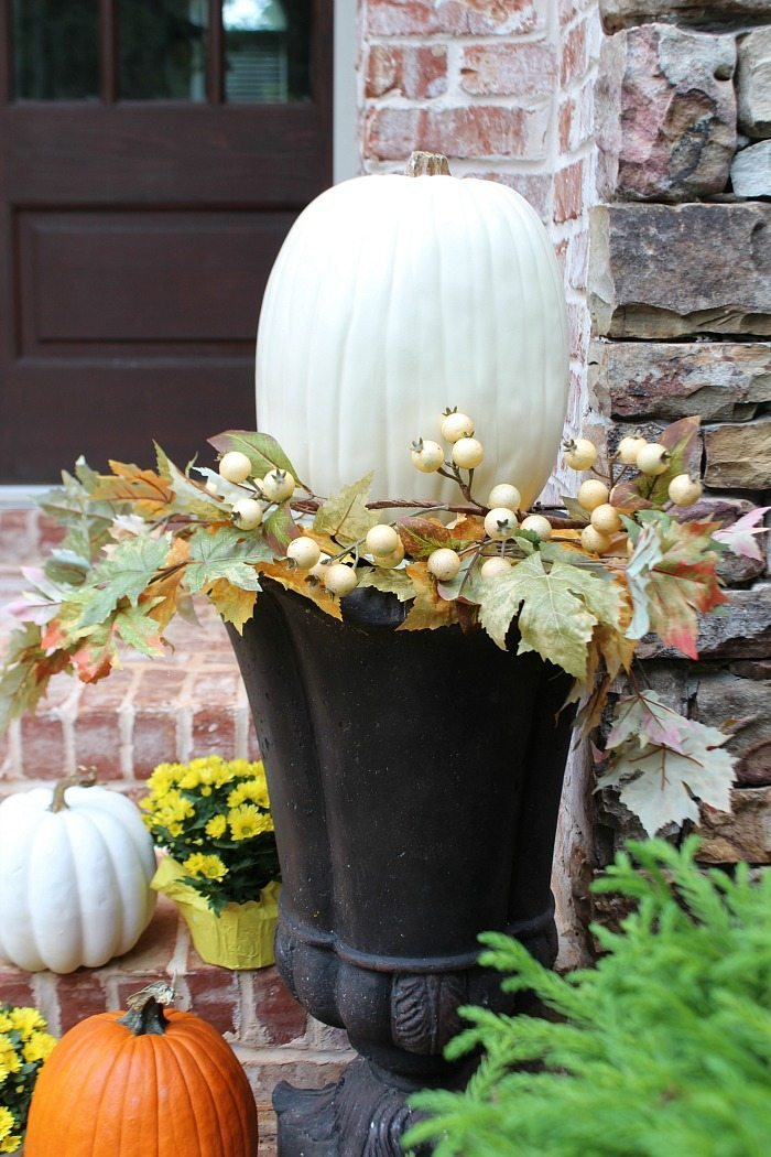 white-pumpkins-in-urns-with-berry-foliage-for-the-fall-front-door