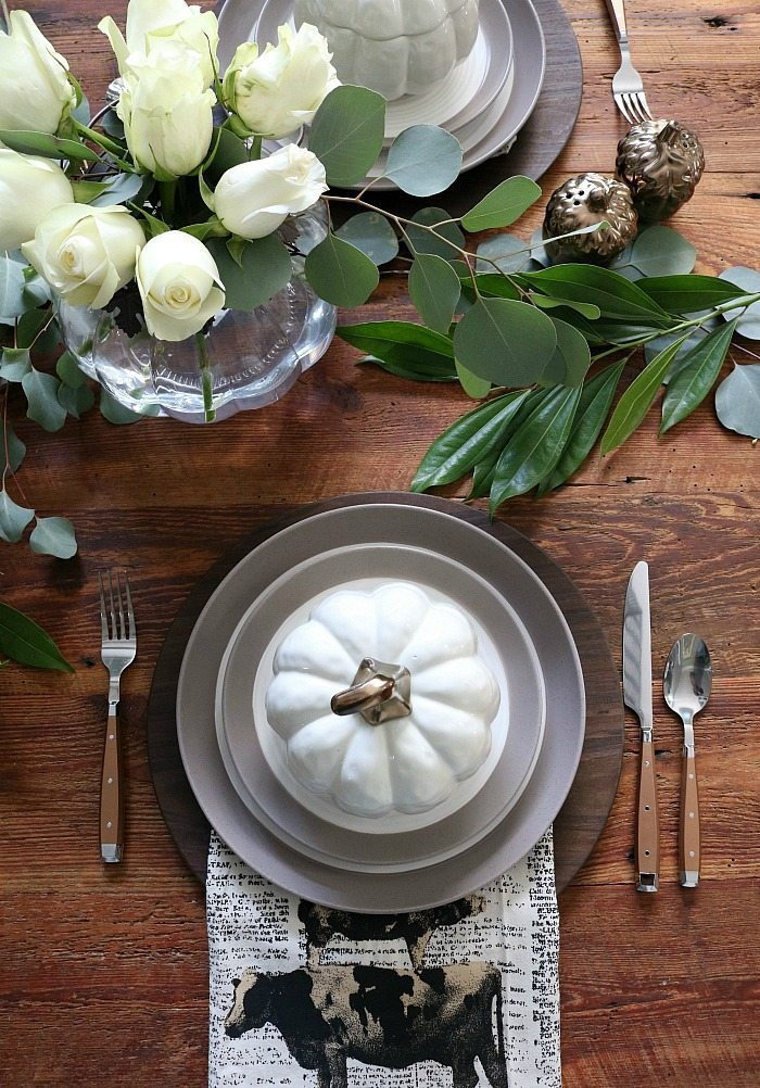 farm-table-set-with-pumpkin-bowls-stoneware-and-cooper-silverware