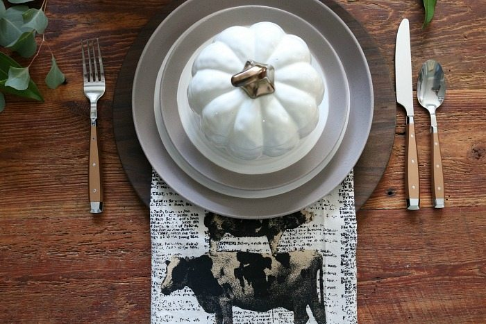farmhouse-inspired-table-setting-with-cooper-silverware-and-little-white-pumpkin-bowls
