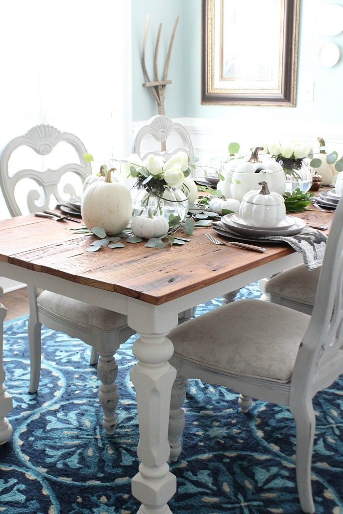farmhouse-table-filled-with-white-pumpkin-decor-and-serve-ware-at-refresh-restyle