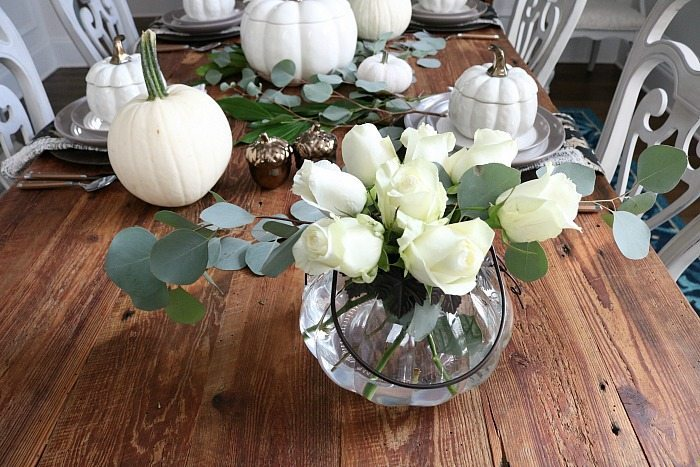 neutral-farmhouse-table-filled-with-white-pumpkins-and-white-roses