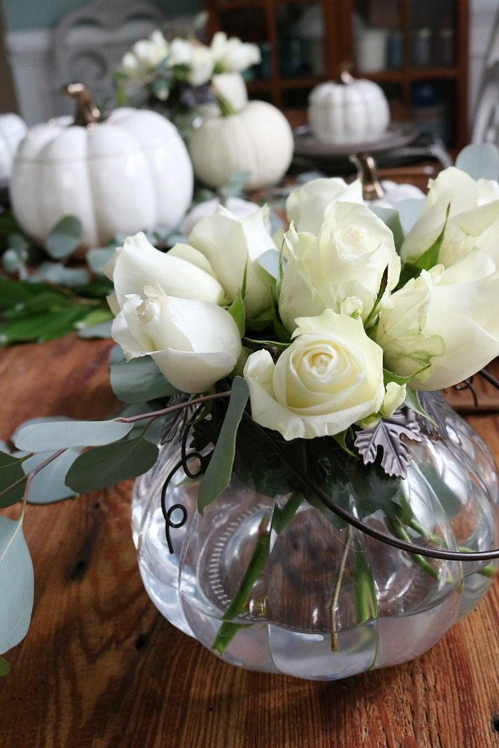 white-roses-in-pumpkin-candle-holder-perfect-for-a-low-profile-arrangement