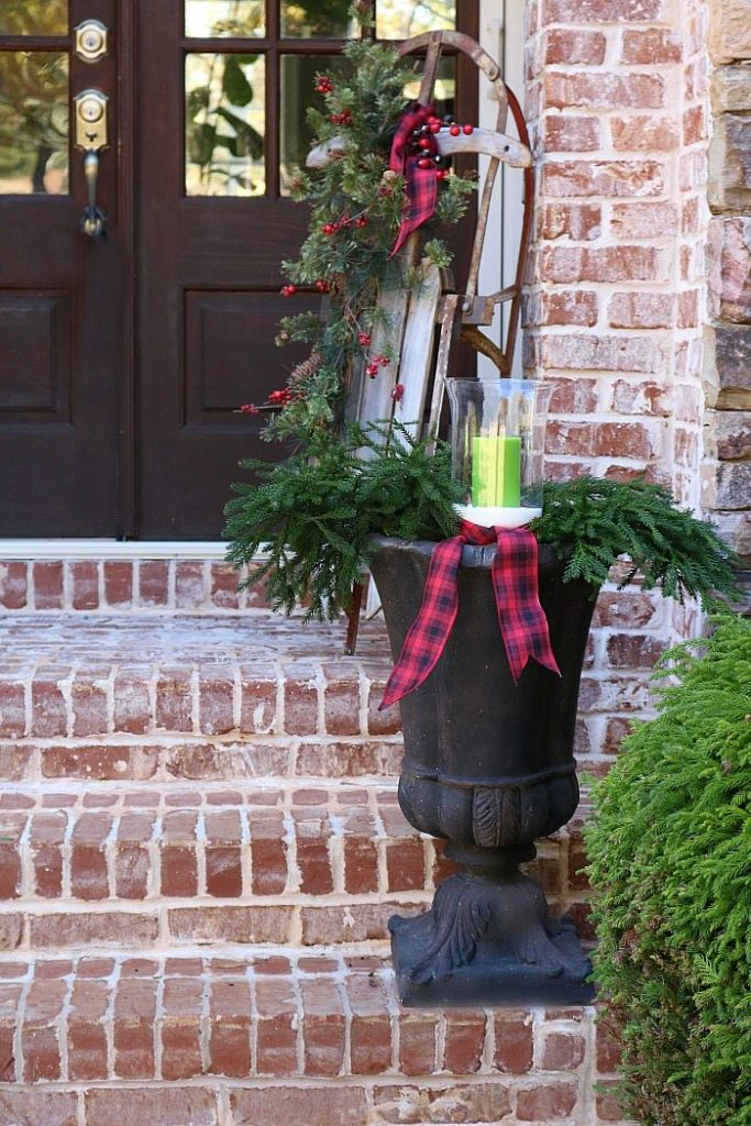 fill-an-urn-with-greenery-and-candles-and-plaid-ribbon-for-a-rustic-look-for-christmas
