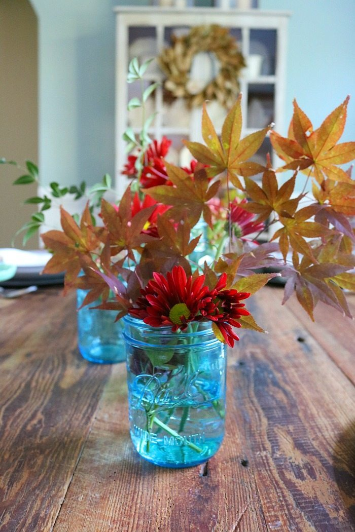 fill-blue-mason-jars-with-leaves-from-the-yard-for-a-pretty-centerpiece