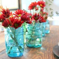 green-and-blue-mason-jars-filled-with-flowers
