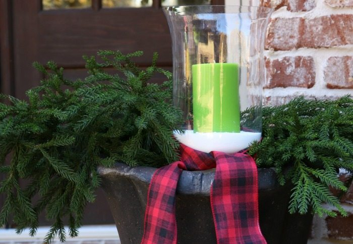 green-candles-greenery-and-plaid-ribbon-for-the-christmas-front-porch
