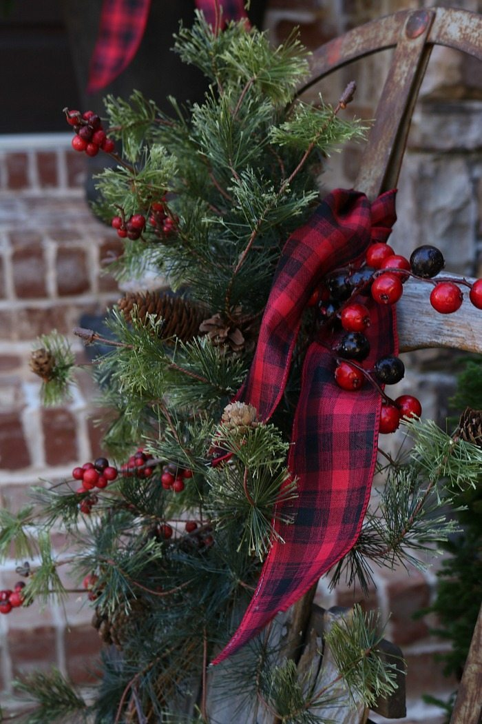 plaid and greenery dress up an old sled - Rustic Christmas Porch Decorating Ideas