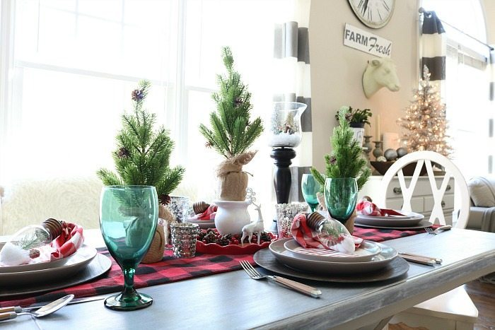 Plaid runner and trees wrapped in burlap for the Christmas table
