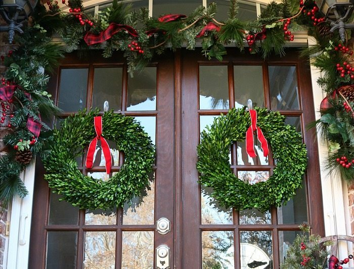 beautiful-preserved-boxwood-wreaths-with-simple-red-ribbons