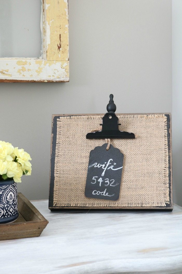 Cute idea - add the wifi code on a chalkboard tag and put it on a burlap photo frame