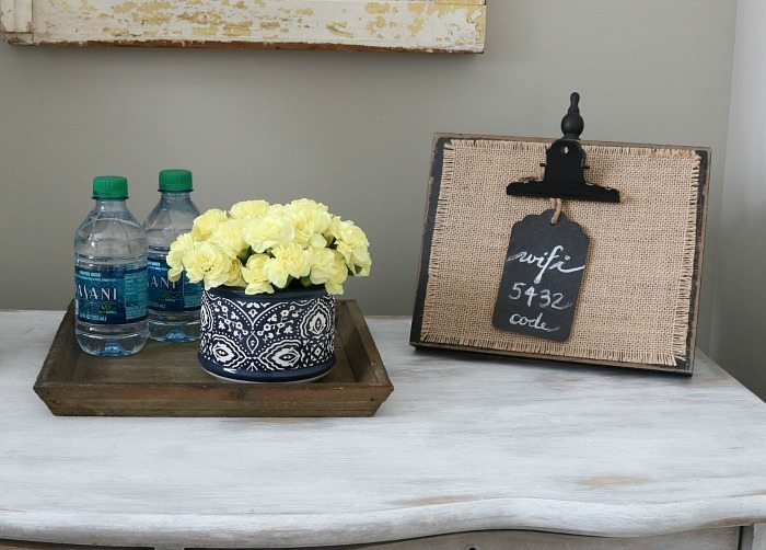 Fresh flower s and bottled water for the guest room.