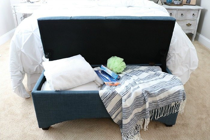Put a bench at the foot of the bed, perfect for storing all the extras for guest and great place to sit