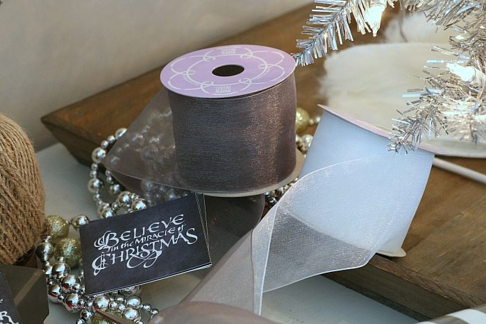 Soft ribbon in gray and white make pretty bows for Christmas presents