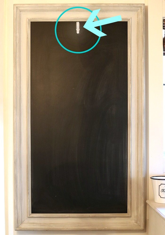 Add a command hook on your chalkboard to hang seasonal decor