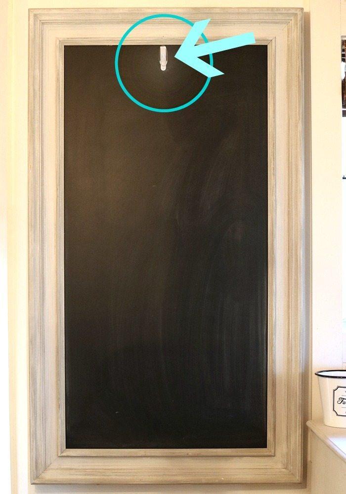 Add a command hook on your chalkboard to hang seasonal decor