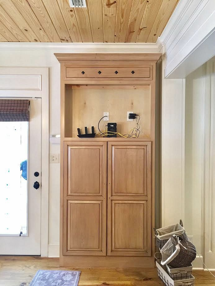 Before tv cabinet is now a mudroom closet
